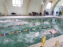 Победители соревнования по плаванию